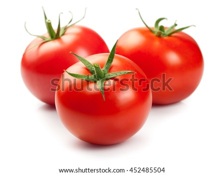 Three red ripe tomatoes isolated on white background - stock photo