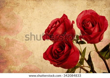 Three red roses on a retro background. Postcard Valentine's Day. Space for text.