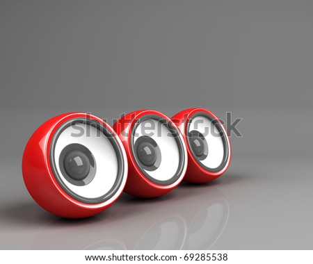 three red speakers over grey