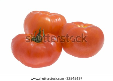 Three red tomatoes on a white background - stock photo