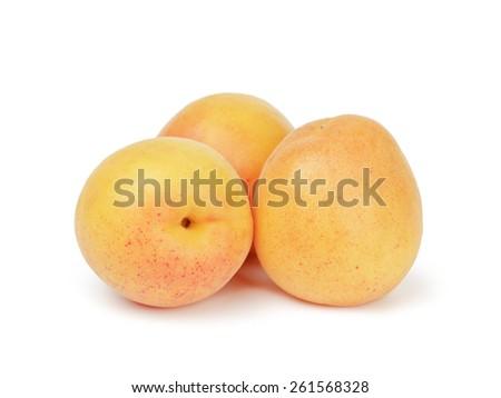 three ripe apricot fruits isolated - stock photo