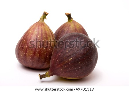 Three ripe figs isolated against white background. - stock photo