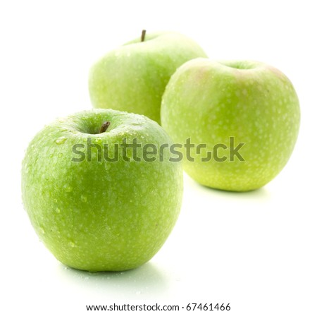 Three ripe green apples. Small DOF, isolated on white