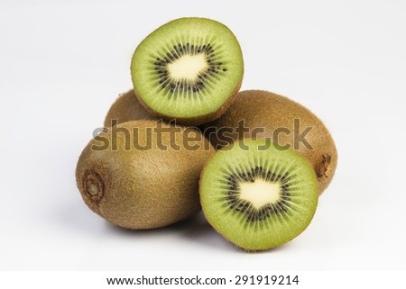 Three ripe kiwi fruits with half - stock photo