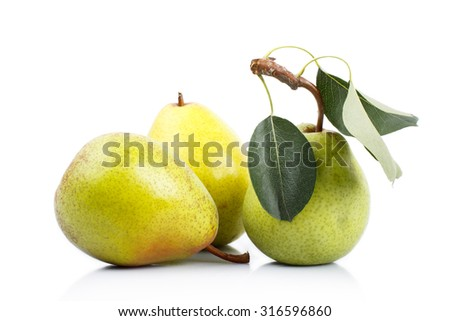 Three ripe pears over white background