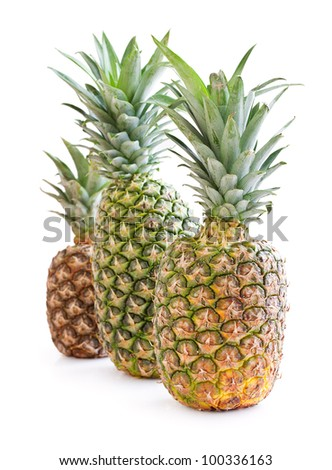 three ripe pineapple on a white background