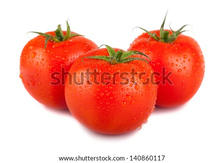 Three ripe red tomato with water drops isolated on white background