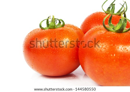 Three ripe tomato with drops isolated on white background - stock photo