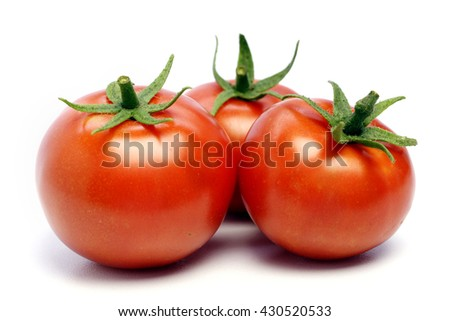 Three ripe tomatoes on white background