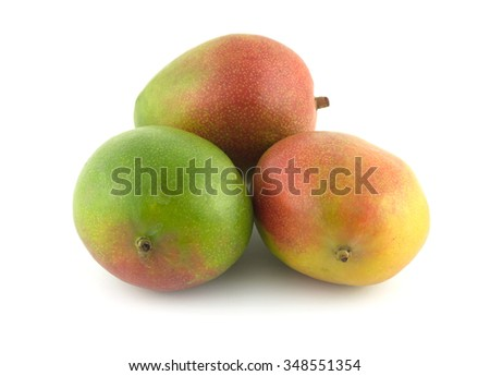 Three ripe tropical fruit mango isolated on white closeup