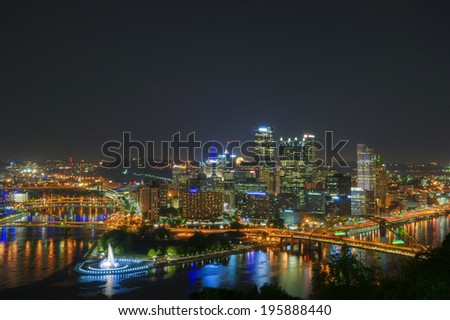 Three rivers meet in downtown Pittsburgh at night. - stock photo