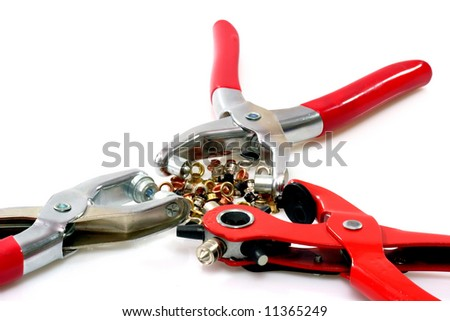Three rivetter tools with metal chinch on bright background.