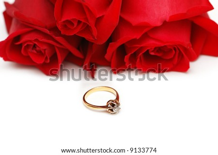 Three roses and ring isolated on the white