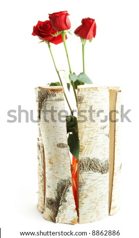 Three roses in a wooden vase - stock photo