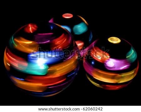 Three rotating disco light-balls on a black background - stock photo