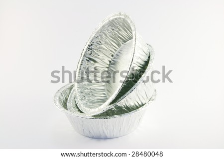 Three round catering trays on a white background