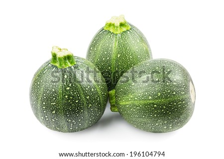 Three round zucchini on a white background - stock photo