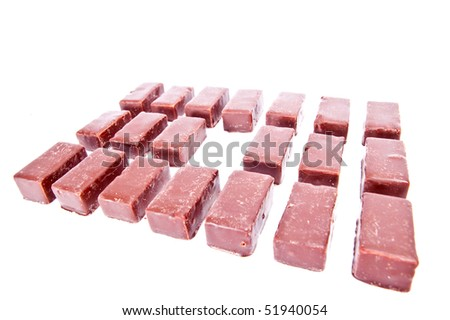 Three rows from chocolate candies isolated on white background