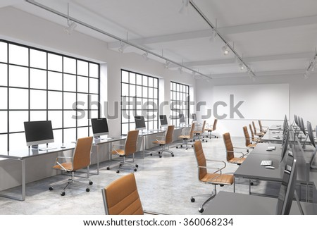 Three rows of computer tables in a light modern open space office, one of them along the window. Big blank screen on the wall. Concept of work. - stock photo