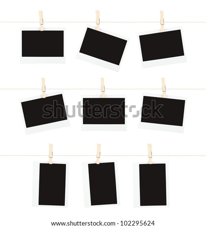 Three rows of three blank pieces of instant film hanging from clothespins on strings isolated on white. - stock photo