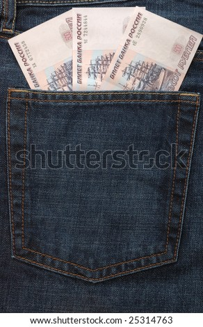 Three russian banknotes in back pocket of jeans