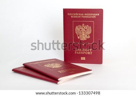 Three russian passports on white background - stock photo