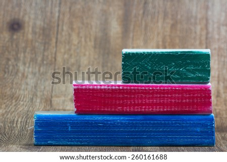 Three rustic wooden blocks blank for text with wood grain background - stock photo
