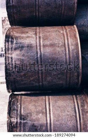 three rusty cans at sunset - stock photo