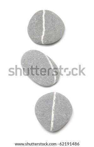 Three sea striped stones isolated - stock photo