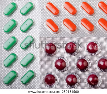 Three section pill bacjground with different kinds of pills - stock photo