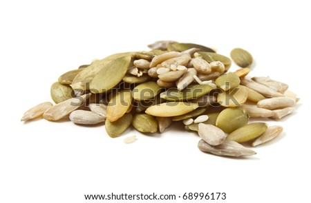 Three seed mixture of  Pumpkin, sunflower and sesame seeds isolated on white. - stock photo