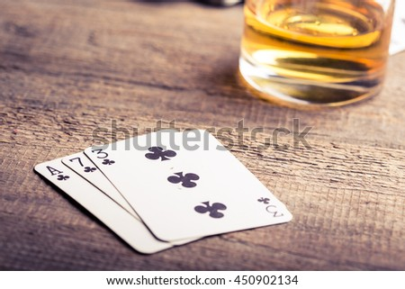 three, seven, ace playing card combination on a wooden table