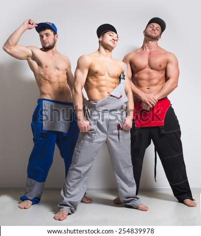 Three sexy man in working overalls - stock photo