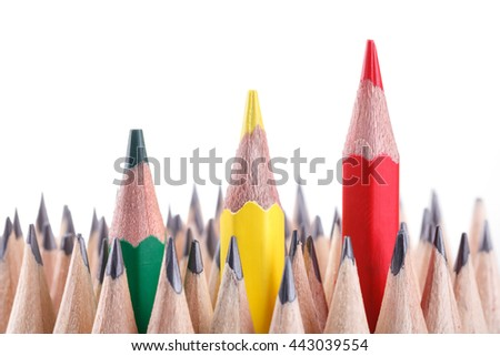 three sharpened green,yellow,red pencil among many ones - stock photo