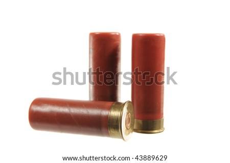 Three shotgun shells isolated on white - stock photo