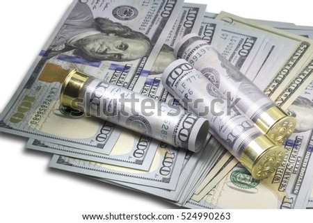 Three Shotgun shells loaded with hundred us dollar banknotes on different usa dollar bills background. Close up image. Selective focus. Concept of money power. Isolated on white background.