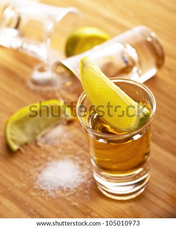 Three shots of tequila with lime and salt