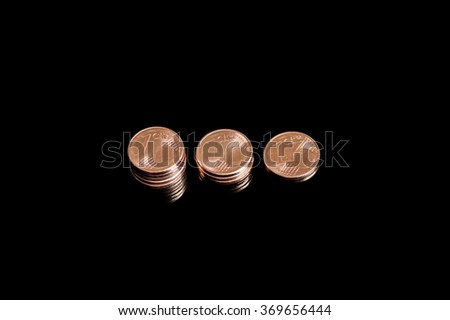 Three shrinking stacks of euro cent coins close-up - stock photo