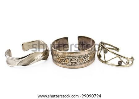 Three silver bracelet isolated on white - stock photo
