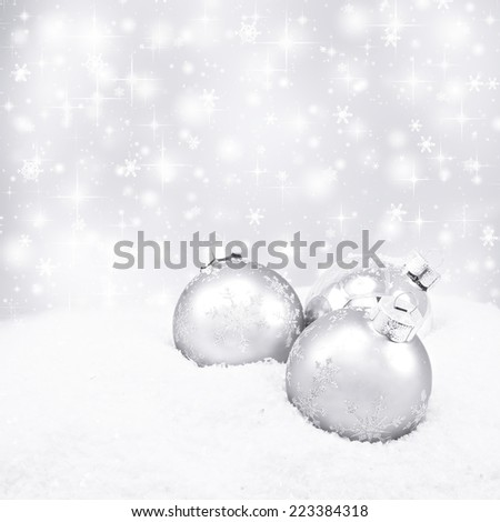 Three silver christmas balls on silver background - stock photo