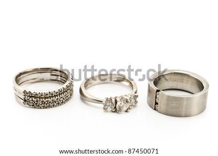 Three silver rings isolated on white - stock photo