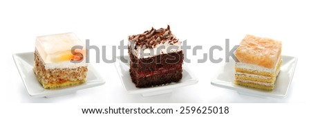 Three Single Cakes With Fruit, Jelly, Chocolate And Cream, Group Of Dessert Cuts, Isolated On White Background - stock photo