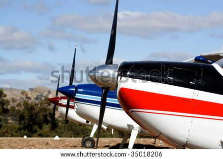 Three single engine planes in a row - stock photo