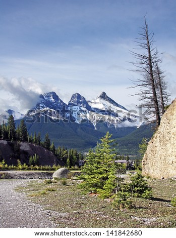 Three Sister Mountains, Canmore, Alberta, Canada  Picture taken on hike up Mount Lady MacDonald. - stock photo