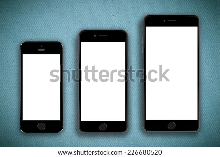 Three sizes of mobile smartphones isolated on blue canvas - stock photo