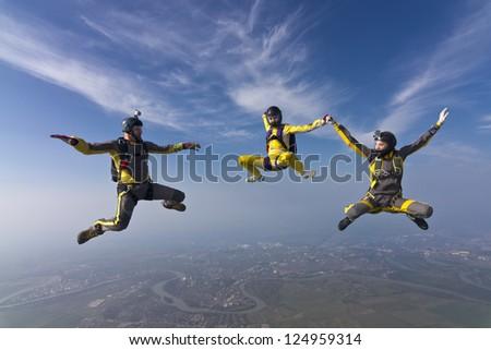 Three skydivers doing shape. - stock photo