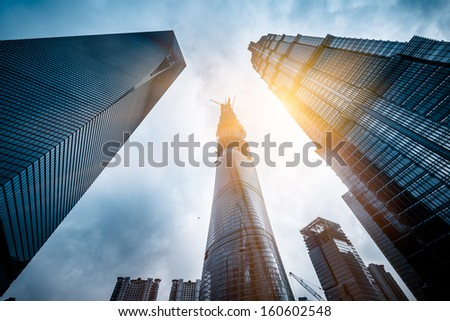 Three skyscrapers with Shanghai Tower on the right under construction in Lujiazui financial district, in Pudong, Shanghai, China. - stock photo