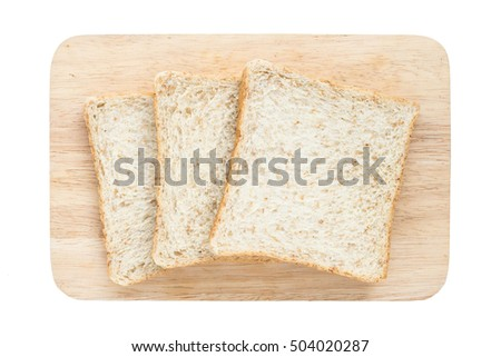 three slice of  whole wheat bread on chopping wood isolated on white background