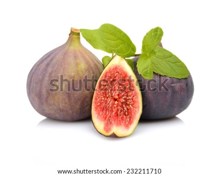 Three sliced figs lengthwise in half with spearmint, isolated on white background