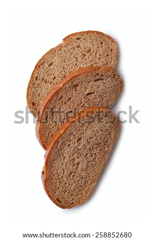 Three slices of freshly baked healthy rye bread lying overlapped on a white background, overhead view - stock photo